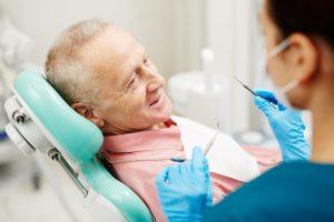 an older gentleman having his teeth checked