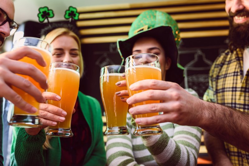 a group of friends celebrating St. Patrick's Day in North Sarasota with beer